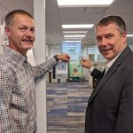 Tim and Kurt Install Best Place to Work Decal - Company Culture